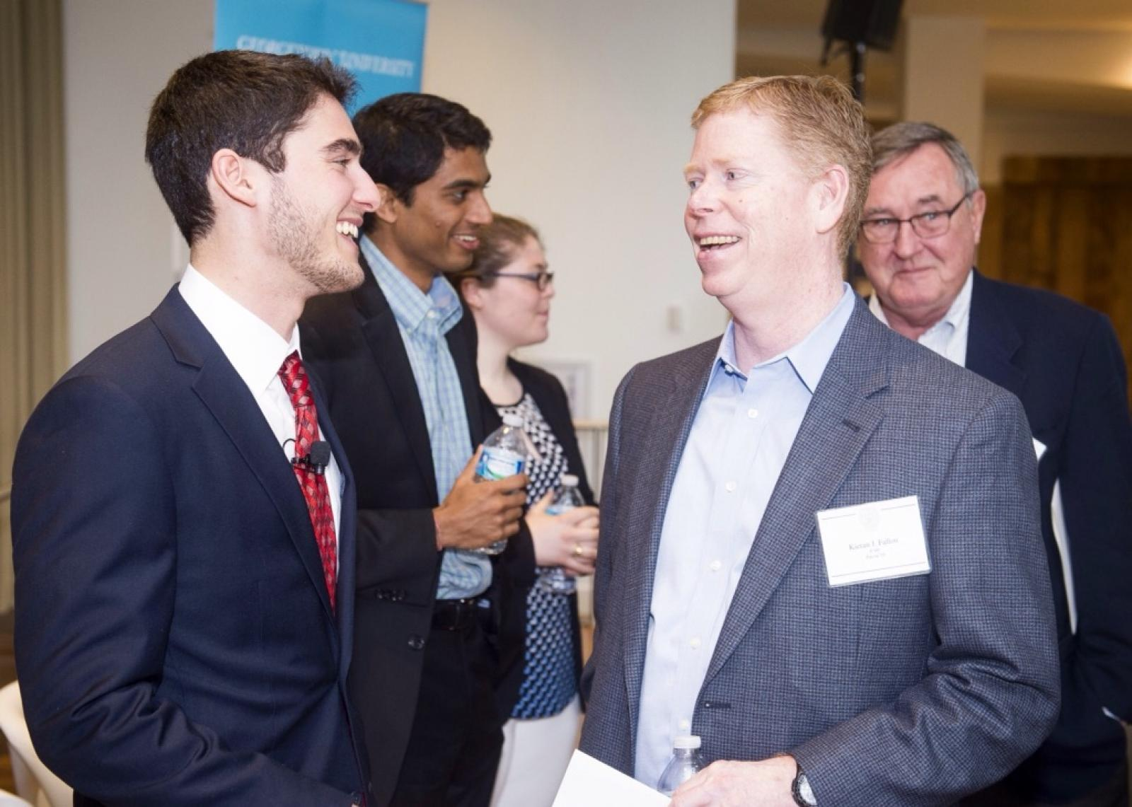 Zachary Kay (F'16) (left) speaks with Kieran J. Fallon (F'88, Parent'19) during the Scholarship Recognition Event in April.
