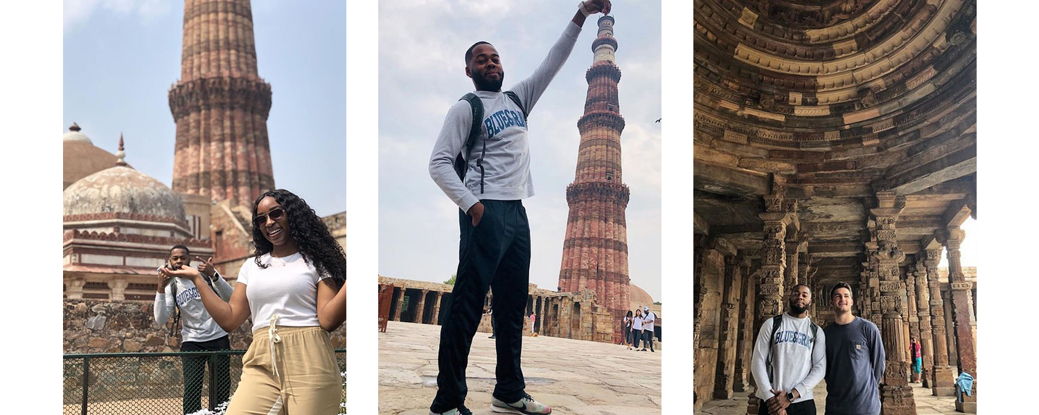 Derron Darryl Payne and Angel Osagie-Erese at Qutub Minar in Delhi, India; Derron Darryl Payne pretending to hold up a tower behind him with his finer on top at Qutub Minar in Delhi, India; Derron Darryl Payne and Henry Campbell Hollinshead at Qutb Complex in Delhi, India