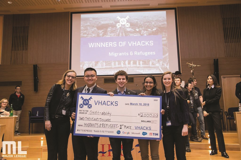 Roisin McLoughlin (C'19) (at right) and her teammates accept a first-place award in the Migrants and Refugees category at VHacks, an event at the Vatican that seeks to use technological innovation to address global problems.
