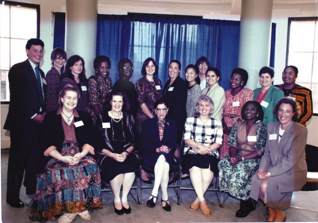 In September 1993, the Women's Law and Public Policy fellowship class invited Justice Ruth Bader Ginsburg (center) to their welcome lunch and 10th anniversary celebration. Christine Webber (back row, fourth from right) was inspired by the event.