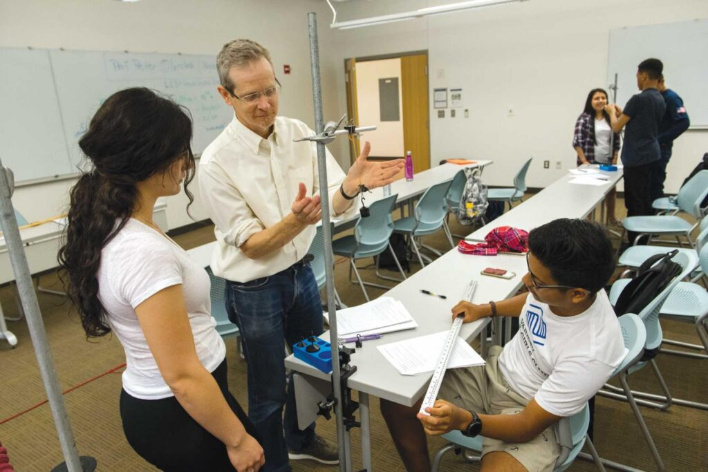 High school students work with Peter Olmsted