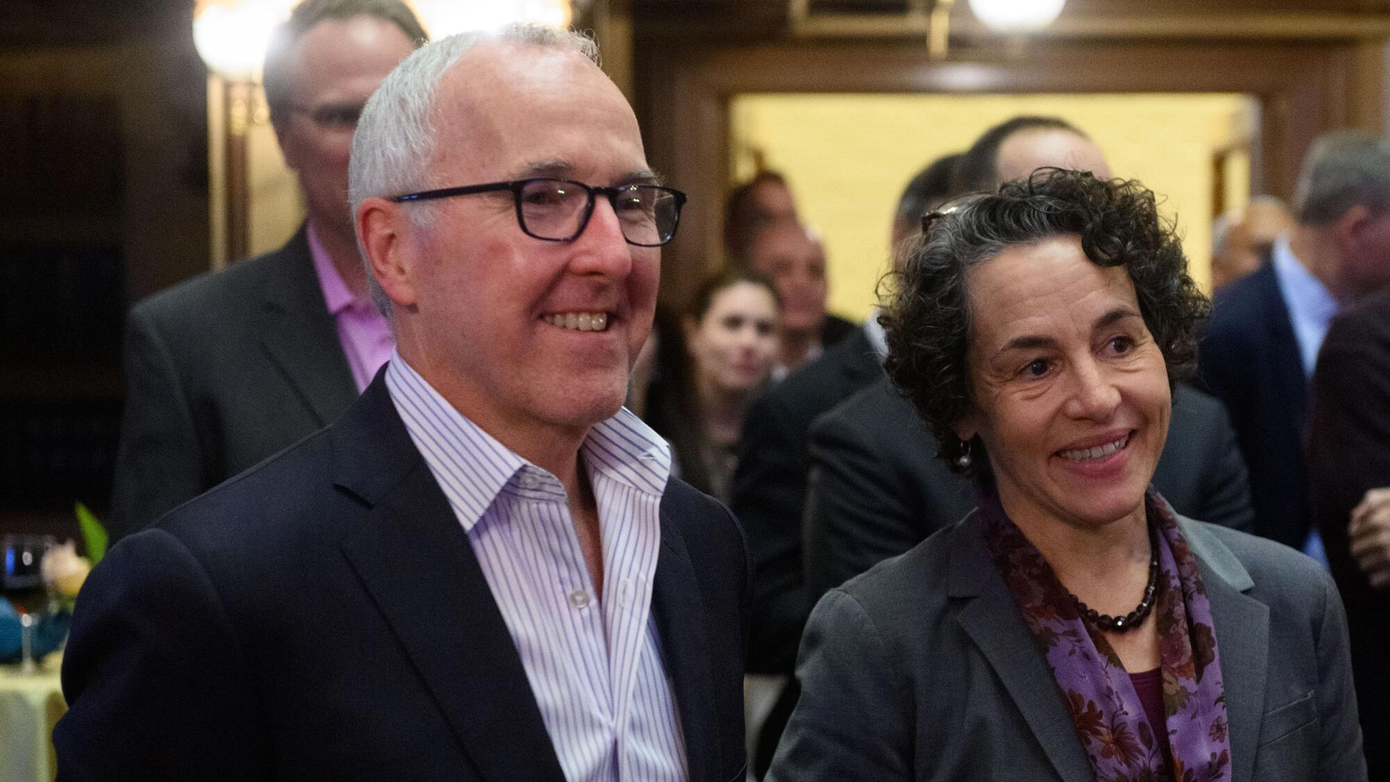 Frank McCourt and McCourt School Dean Cancian smiling at an event