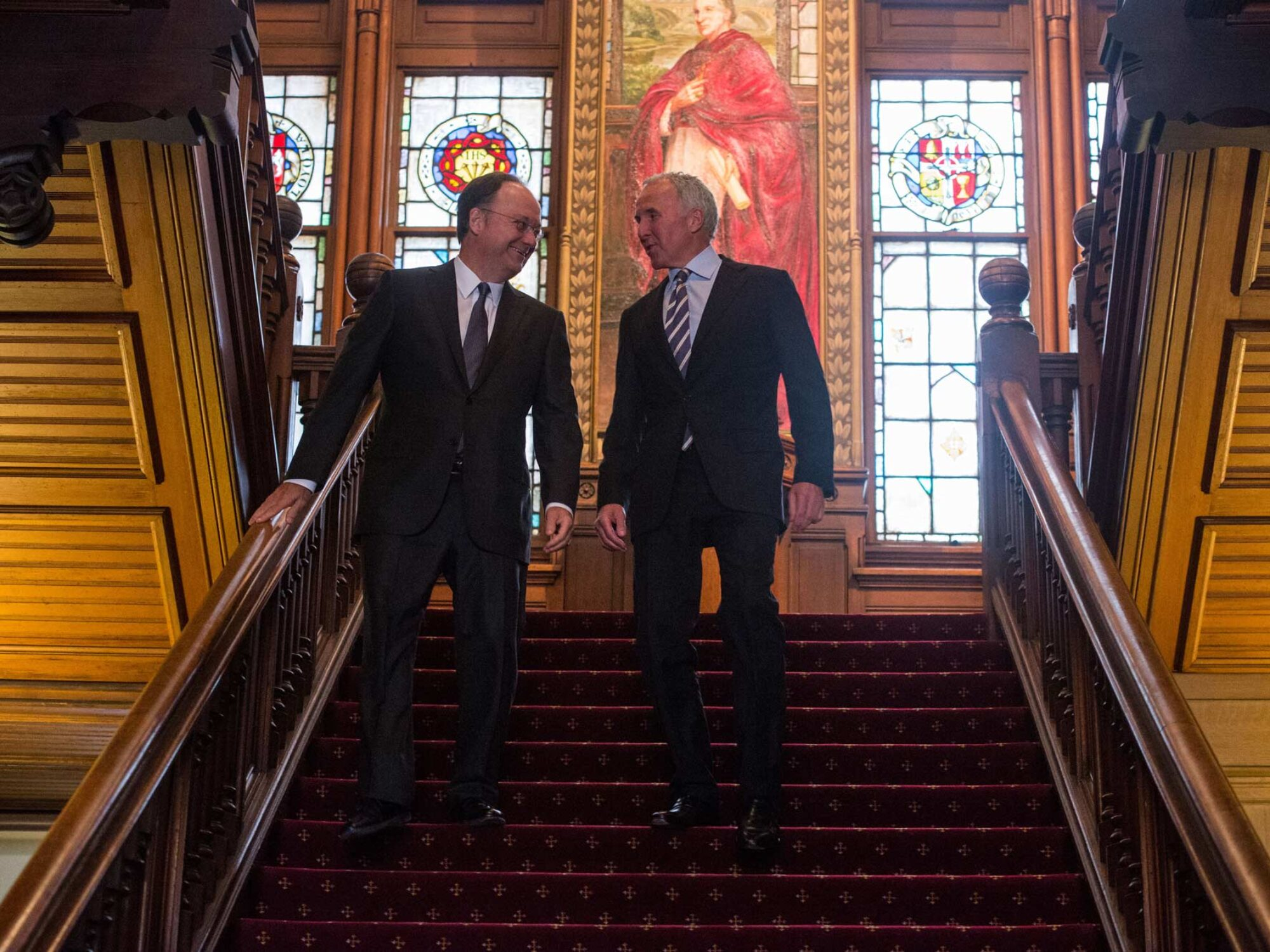 Georgetown University President DeGioia and Frank McCourt descending stairs in Healy Hall