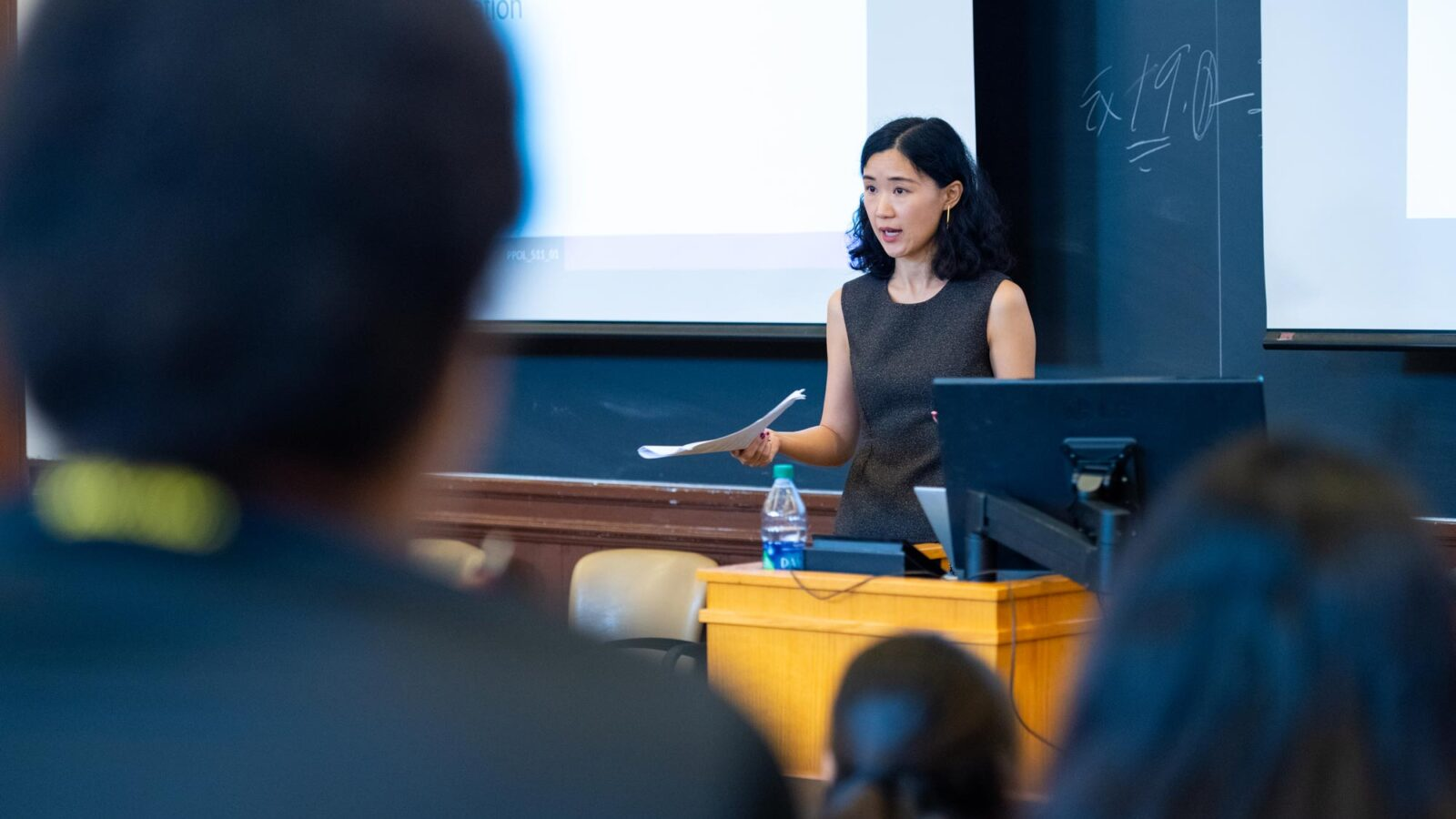 Ning Leng, McCourt School assistant professor, lecturing to classroom of students