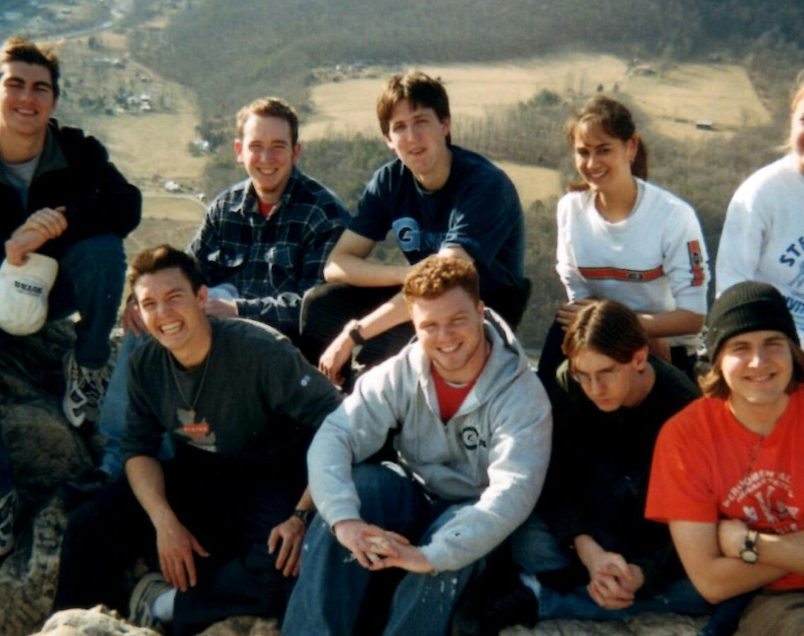 Daniel Rigby with friends at a scenic viewpoint in West Virginia