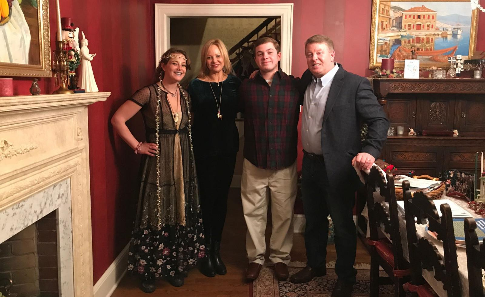 Claire, Rebekah, Paul Jr., and Paul Simpson standing together in their Ridgewood, New Jersey home.